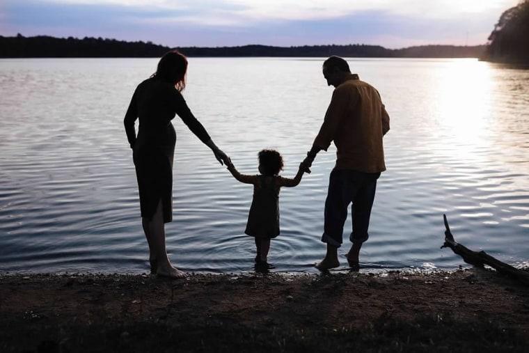 Katie Walker Heinin, with her  husband Emile and daughter Hayden.