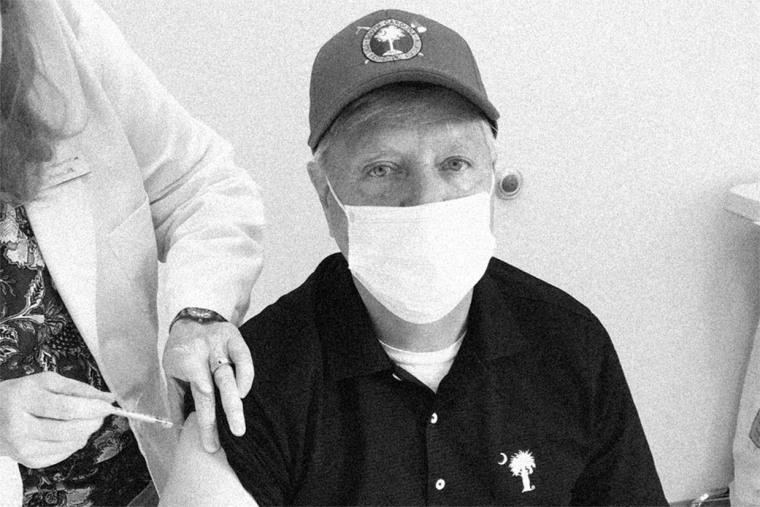 Sen. Lindsey Graham, R-S.C., receives a Covid-19 vaccine.