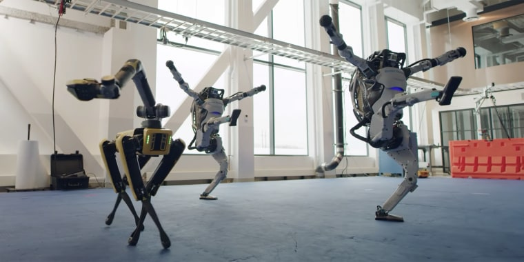 From left to right, Boston Dynamic's Spot robot and two of its Atlas robots show off their flexible moves in a December video.