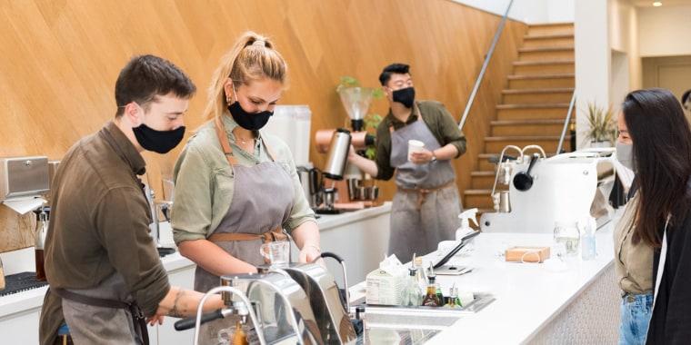 Joshua Kaplowitz, Katarina Smit and Jason Yeo serve customers at Saint Frank Coffee in Russian Hill, San Francisco, Calif.