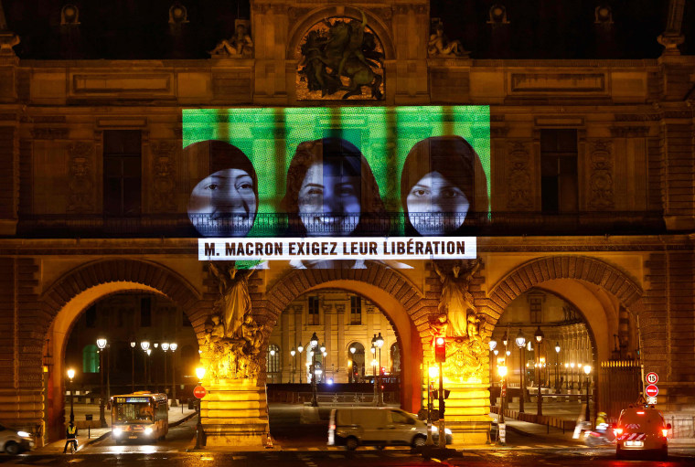 Image: A projection on the Louvre Museum in Paris