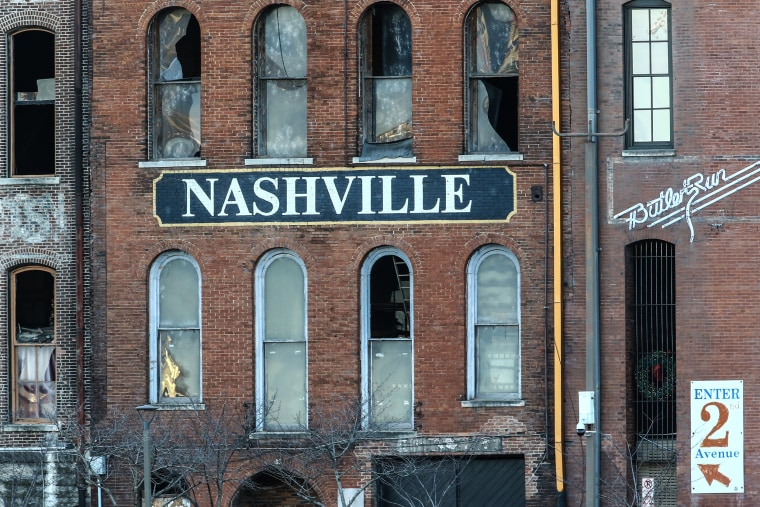 Image: A building in Nashville with broken glass windows after an explosion.