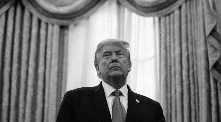 Image: Donald Trump stands in the Oval Office of the White House.