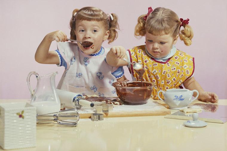 Girls sitting with chocolate sauce