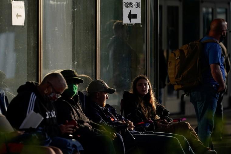 Image: People wait outside Kentucky Career Center in Frankfort