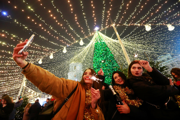 Image: Revellers take part in New Year's Eve celebrations in Kyiv
