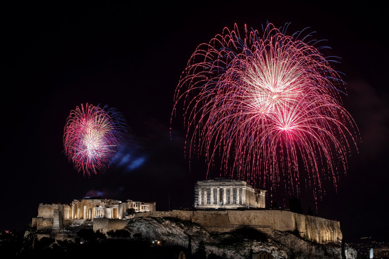 Image: Fireworks explode over the ancient Parthenon temple atop the Acropolis hill during New Year's day celebrations, amid the coronavirus disease (COVID-19) pandemic in Athens