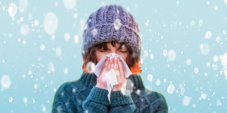 Woman blowing her nose in the snow