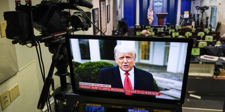 President Donald Trump speaks on a monitor in the White House briefing room about the violence in Washington on Wednesday.