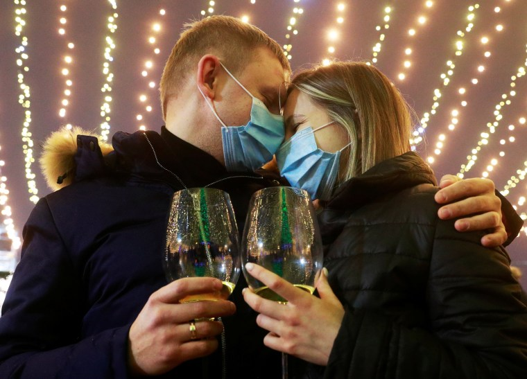 Image: A couple embrace during New Year's day celebrations in Kyiv
