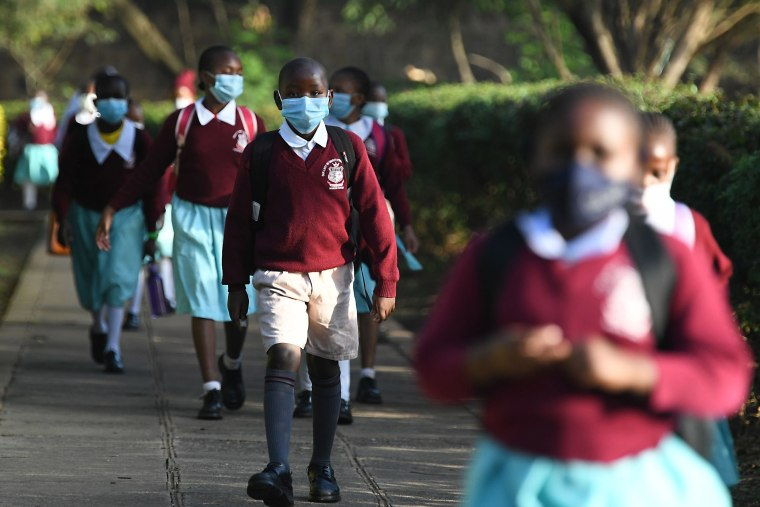 Image: Kenyan school children wear face masks while walking to school as they resume in-class learning after a nine-month disruption caused by the Covid-19 coronavirus pandemic, in Nairobi