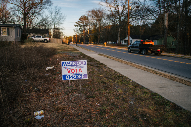 Image: A U.S. Senate campaign sign for Democratic candidates Jon Ossoff and Raphael Warnock is seen on Jan. 3, 2021 in Rome, Ga.