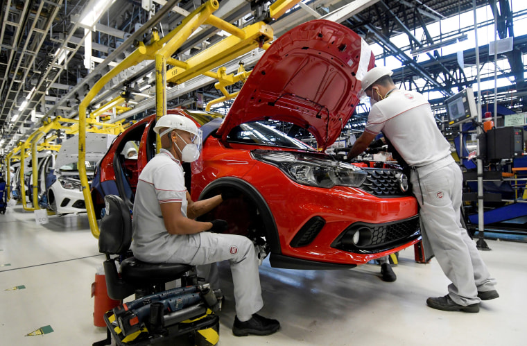 Image: Fiat Chrysler Automobiles assembly workers build a 2020 Argo at the Assembly Plant in Betim near Belo Horizonte, Brazil.