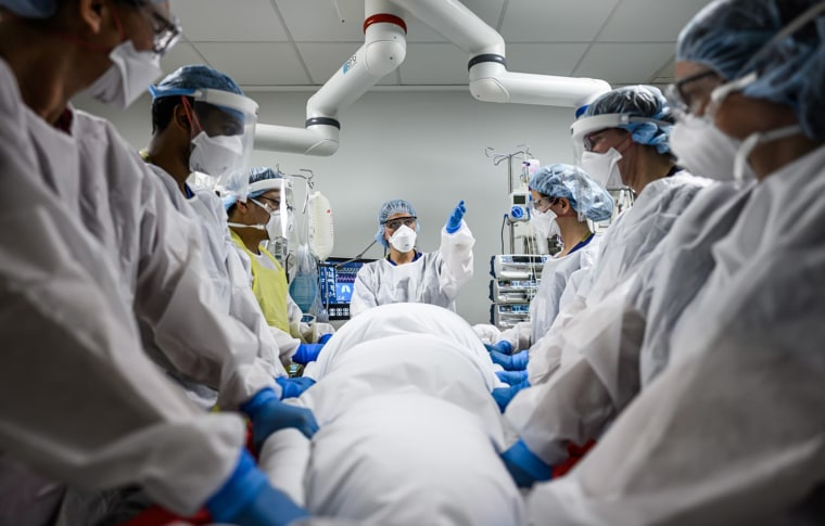 Image: The team leader, an ICU Doctor directs her team in the important upcoming stages of the procedure - checking all members are ready