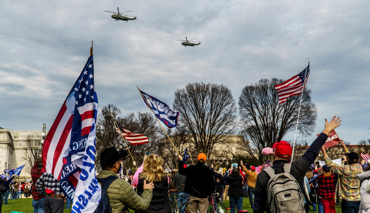 Image: Two helicopters fly over the crowd of Trump supporters on the National Mall in Washington DC