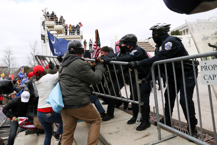 Image: Supporters of President Donald Trump clash with police officers outside of the Capitol on Jan. 6, 2021.