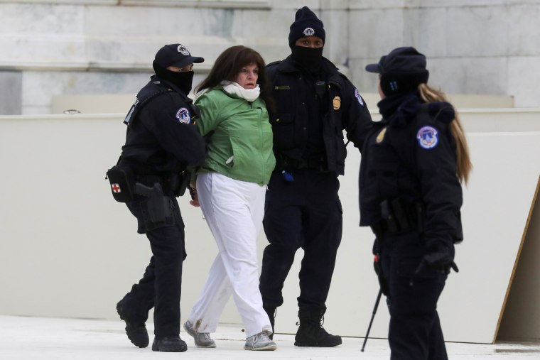Image: Police officers detain a woman after a clash with supporters of U.S. President Donald Trump outside of the U.S. Capitol Building in Washington
