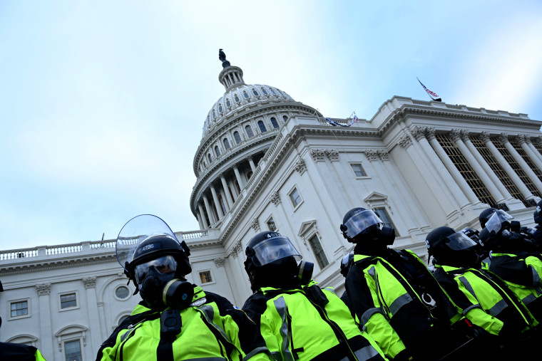 Image: Police stand guard as protesters gather near the Capitol on Jan. 6, 2021.