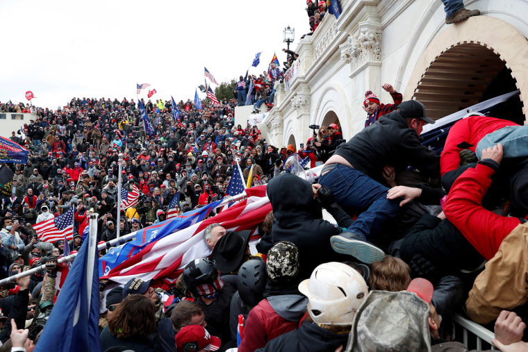 Image: Pro-Trump protesters storm into the U.S. Capitol during clashes with police, during a rally to contest the certification of the 2020 U.S. presidential election results.