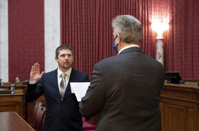 State Del. Derrick Evans, left, takes the oath of office Dec. 14 in Charleston, W.Va.