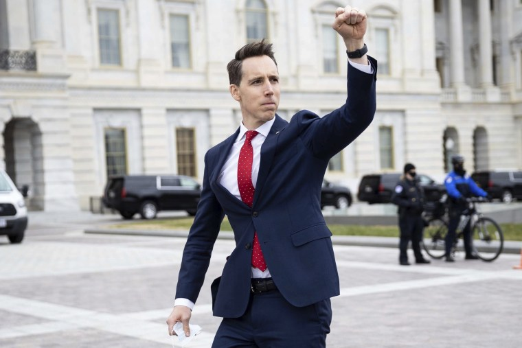 Image: Sen. Josh Hawley, R-Mo. raises his fist toward a crowd of supporters of President Donald Trump gathered outside the Capitol