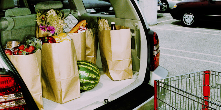 Groceries in back of car, parked in parking lot (Cross Processed)
