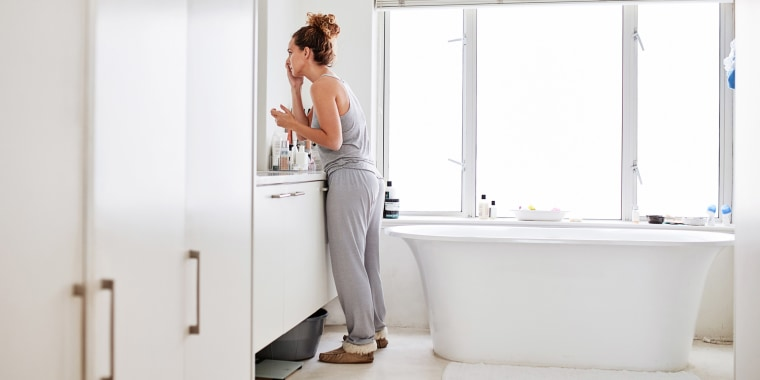 Woman in her white bathroom