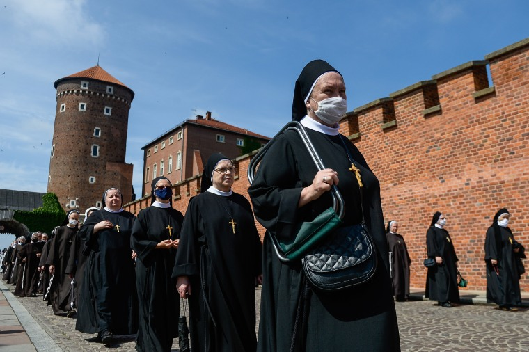 Image: Nuns wear protective face masks as they take part in a collective mass on Krakow's Wawel Castle