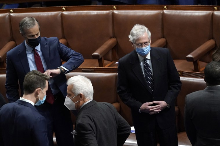 Image: Senate Majority Leader Mitch McConnell in the House Chamber during a reconvening of a joint session of Congress