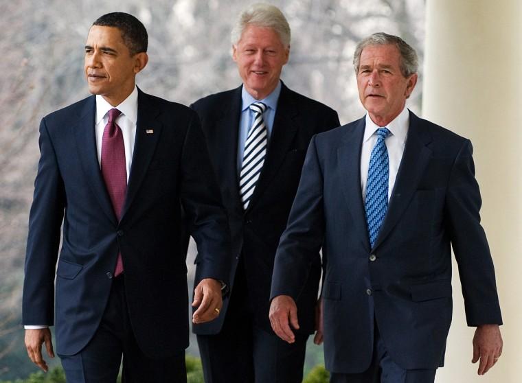 Image: US President Barack Obama (L) walks down