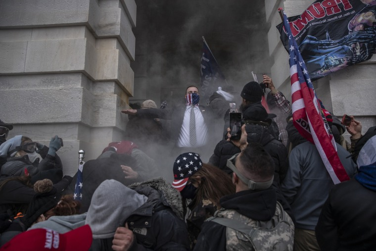Image: Demonstrators attempt to break into the U.S. Capitol