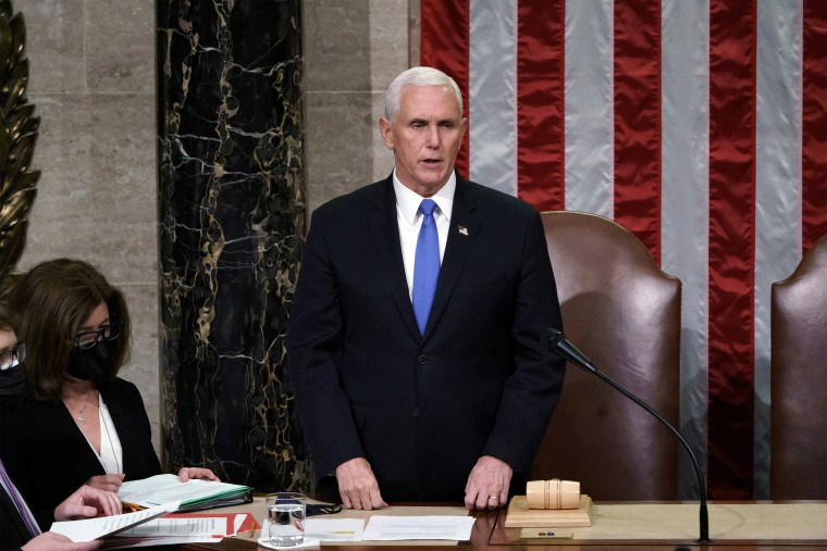 Image: Vice President Mike Pence reads the final certification of Electoral College votes cast in November's presidential election at the Capitol,