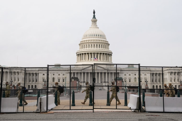 Image: Security fencing surrounds the U.S. Capitol days after supporters of U.S. President Donald Trump stormed the Capitol in Washington