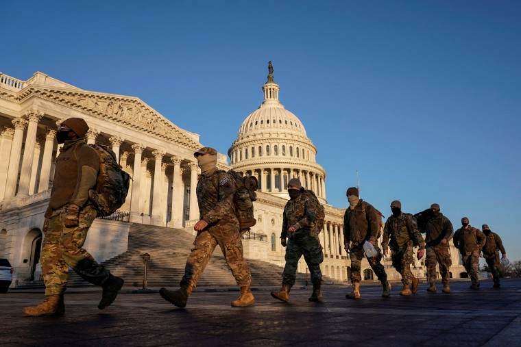 Image: Members of the National Guard arrive at the U.S. Capitol in Washington