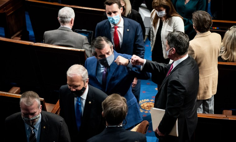 Image: Ted Cruz fist bumps with a house member followed by Josh Hawley.