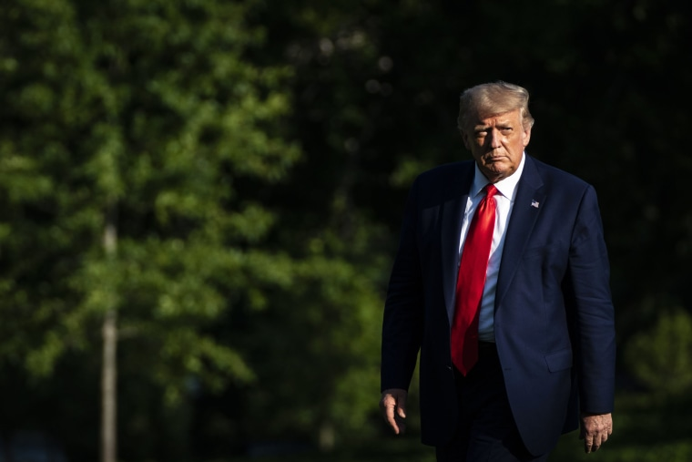 Image; President Donald Trump disembarks Marine One on the South Lawn of the White House on July 15, 2020.