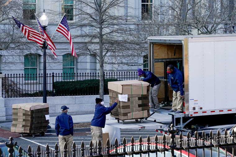 Image: Workers unload pallets of unfolded boxes at the Executive Office Building on the White House grounds in Washington