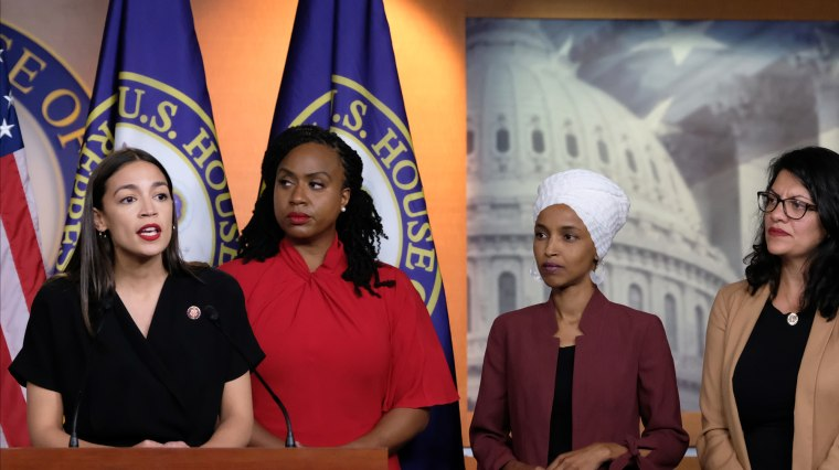 Image: Congresswomen Alexandria Ocasio-Cortez, Ayanna Pressley, Ilhan Omar and Rashida Tlaib on stage