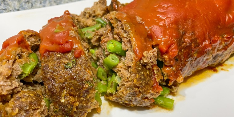 This vintage Campbell's soup meatloaf recipe involves rolling frozen green beans into the loaf before baking.