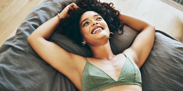 Woman laying in her bed in her bra