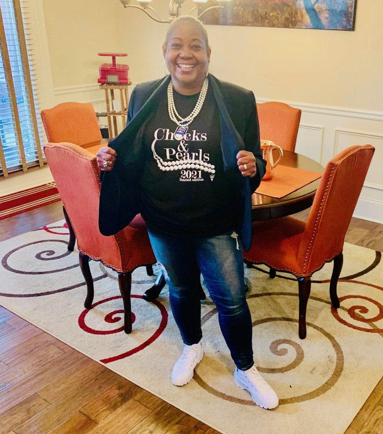 "Felicia Cheek gets ready for Inauguration Day 2021 by wearing a ""Chucks and Pearls"" T-shirt, sneakers and a pearl necklace."