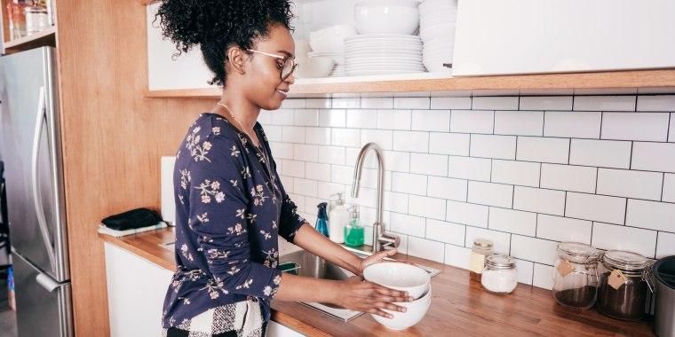 Woman organizing kitchen