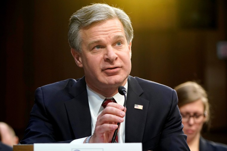 """Image: FBI Director Christopher Wray testifies to the Senate Intelligence Committee hearing about \""""worldwide threats\"""" on Capitol Hill in Washington"""