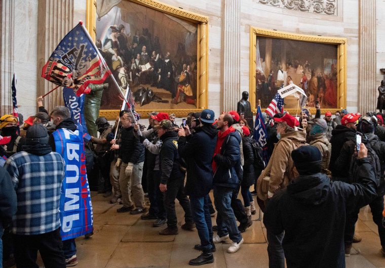 Supporters of President Donald Trump riot in the Capitol Rotunda on Jan.  6, 2021.
