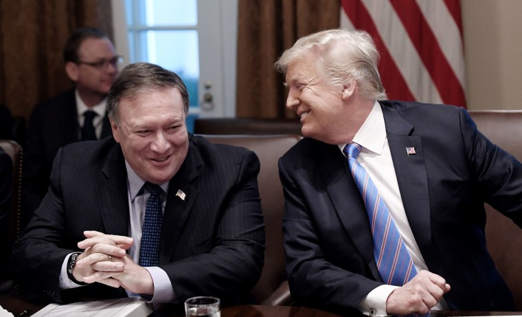 Image: Secretary of State Mike Pompeo and President Trump share a laugh during a cabinet meeting with U.S. President Donald Trump in the Cabinet Room of the White House.