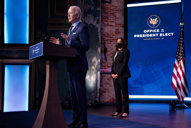 Vice President-elect Kamala Harris listens while as President-elect Joe Biden speaks at the Queen Theater on Dec. 28, 2020, in Wilmington, Del.