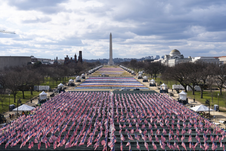 Image: Flags are placed on the National Mall, looking towards the Washington Monument, and the Lincoln Memorial, ahead of the inauguration of President-elect Joe Biden and Vice President-elect Kamala Harris