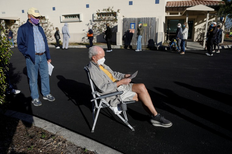 Image: Elderly people, who are 65 and over, wait in line at the Department of Health Sarasota Covid-19 vaccination clinic in Sarasota, Fla.