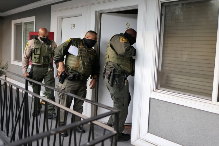 Image: Los Angeles Sheriff's Deputies open the door of an empty apartment to carry out an eviction order, as the spread of the coronavirus disease (COVID-19) continues, in Los Angeles
