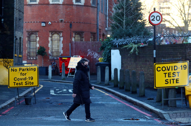 Image: A person walks past the entrance to a testing site amid the Covid-19 pandemic in London